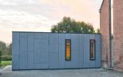 Uitbreiding woning met gevelbeplating te Grembergen